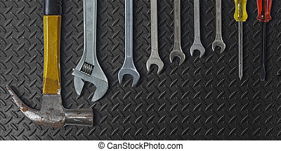 Set of hand tools on metal background