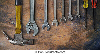 Set of hand tools on old cement background