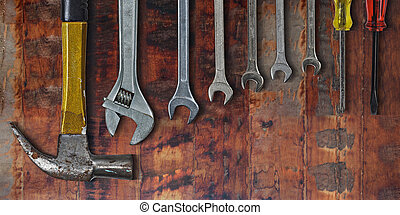 Set of hand tools on old wooden background