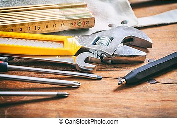 Set of hand tools on wooden background
