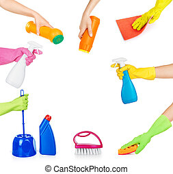set of hands holding household chemicals for cleaning ...