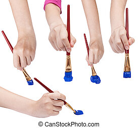 set of hands with art paintbrushes with blue tips