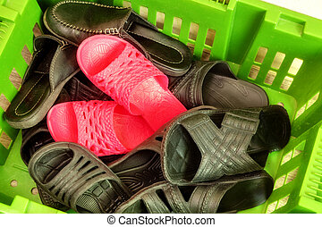 set of house-shoes in a big basket