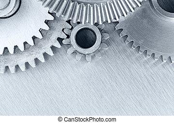 set of industrial metal cogwheels on scratched background