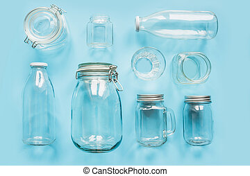 Set of jars on blue background for zero waste storage and shopping.