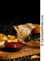 Set of junk food with hamburger and fried potatoes