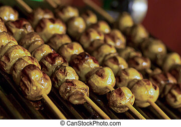 set of kebab whole mushrooms champignons mini on wooden skewers grilled on a focus in the foreground