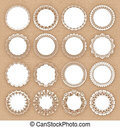 Set of lacy white frames on cardboard background
