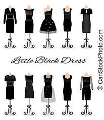 Set of little black dresses on mannequins. Cocktail dresses.