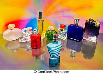 set of luxury perfume bottles on colorful background