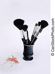 Set of makeup brushes and loose powder