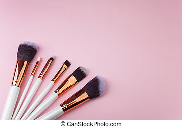 Set of makeup brushes on pink background. Top view point, flat lay. Top view.