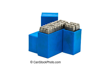 Set of metal stamp alphabet and number punch in blue plastic box isolated on white background with clipping path.