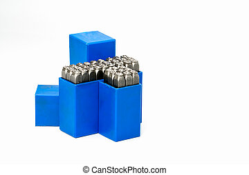 Set of metal stamp alphabet and number punch in blue plastic box isolated on white background with copy space