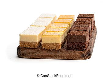 Set of mini cheesecake bites isolated on white
