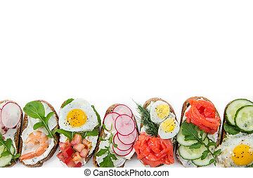 Set of mini sandwiches isolated on white