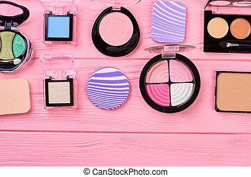 Set of multicolored eyeshadows, top view.
