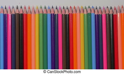 Set of multicolored pencils moving from right to left, sharp ends, pluralism, art, tools for expressing imagination, art. Stop motion. Close up.