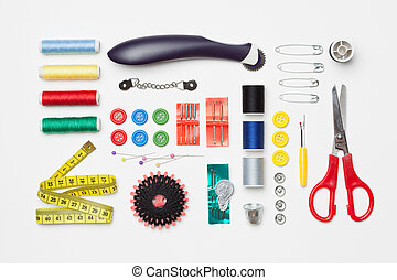 Set of tools with scissors, needle, thread spools for home made embroidery, needlework and tailoring, isolated on white background.