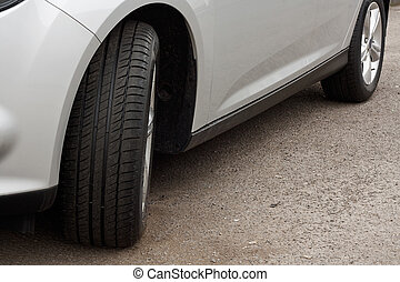 brand new set of unworn used tyres on a motor vehicle or car