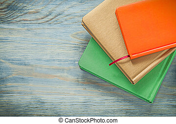 Set of notepads on wooden board education concept
