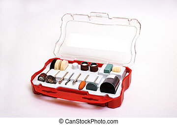 Set of nozzles for engraver in plastic box on white background