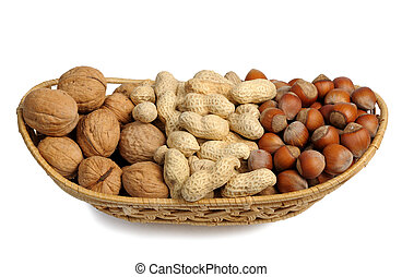 Set of nuts in a wicker basket, isolated