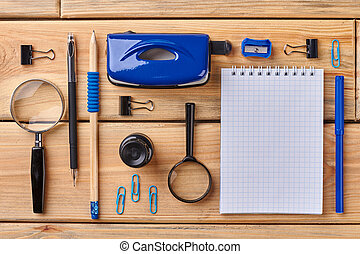 Set of office accessories with blank notebook.