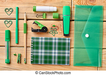 Set of office supplies on wooden background.