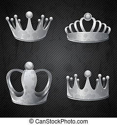 Set of old silver crowns isolated.