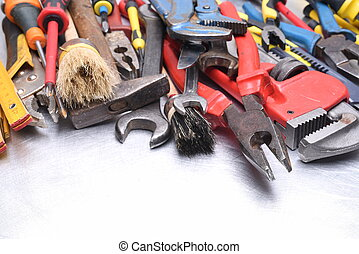 Set of old tools on grey metal background