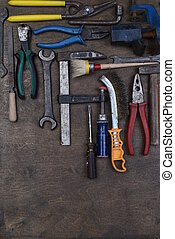 Set of old tools on wooden background