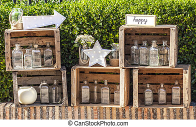 Set of old vegetables wooden boxes over garden background