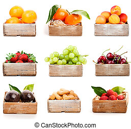 Set of orange, tangerine, apricot, strawberry, grape, cherry, nuts in the wood box. isolated on white background
