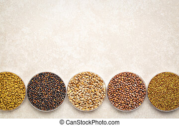 set of organic sprouting seeds on ceramic background