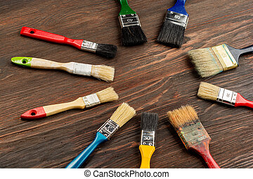 Set of paint brush on wooden background top view. - Set of...