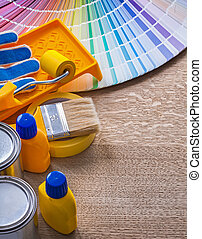 Set of painting tools on wood board construction concept