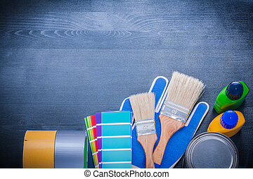 Set of painting tools on wooden board construction concept