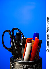 Set of pens on the blue background