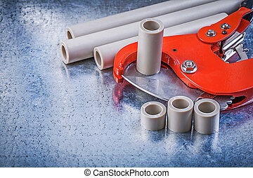 Set of pipe coupling tools on metallic background construction c
