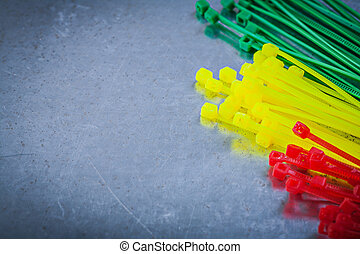 Set of plastic cable ties on scratched metallic background