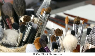 Set of professional brushes for make-up on table in dressing...