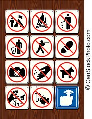 Set of prohibitive icons of not camping, no bonfire, littering, hunting,  stepping, fishing, silence. Icons in blue color on wooden background. Vector image