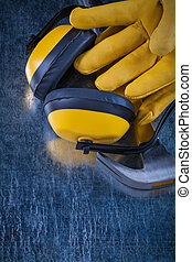 Set of protective workwear on scratched metallic background cons