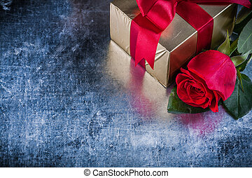 Set of red rose present box on scratched metallic background