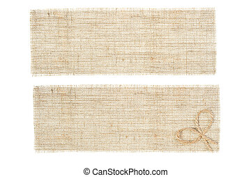 set of sackcloth tags with decor over white