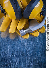 Set of safety workwear on scratched metallic background construc