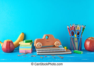 set of school supplies: notebook, pencils, stickers, paper clips, scissors
