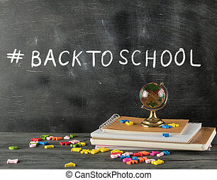 set of school supplies on a black background