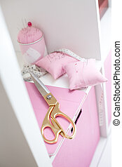 Set of sewing scissors, measuring tape, fabric and pins for...